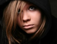 Portrait of the young girl in a black hood